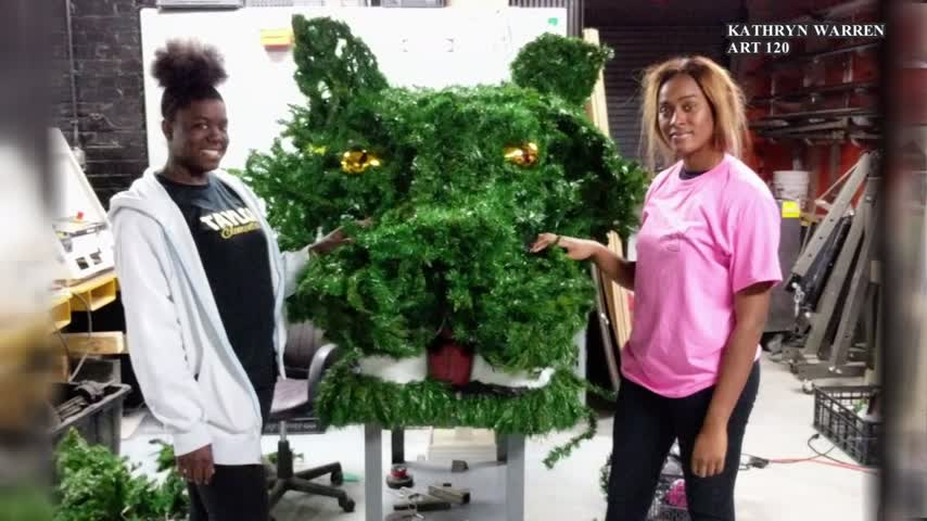 Students make an art car at Howard High